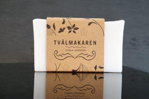 Ekologisk Handgjord tvål. Rektangulärgformad och inslagen i brunt papper med Tvålmakarens logga på. Vit färg, Återfuktande.