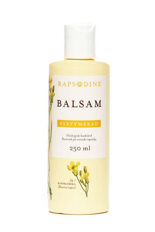 250 ml Balsam i ljusgul förpackning. Cylinderformad med vitt lock. Parfymerad. Rapsblommor i gul färg målade. Rapsodine i gul text överst på förpackning.