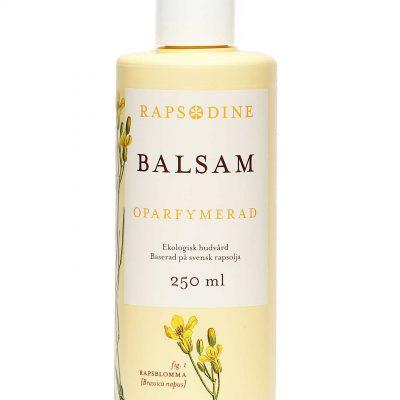 250 ml Balsam i ljusgul förpackning. Cylinderformad med vitt lock. Oparfymerad. Rapsblommor i gul färg målade. Rapsodine i gul text överst på förpackning.