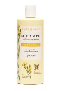 500 ml Schampo i ljusgul förpackning. Cylinderformad med vitt lock. Parfymerad. Rapsblommor i gul färg och röda havtornsbär målade. Rapsodine i gul text överst på förpackning.